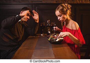 Quarrel of couple in restaurant, bad evening