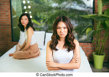 quarrel two friends. Two women screaming at each other