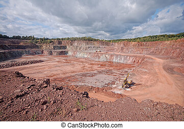quarry mine of porphyry rock. driller in a mine.