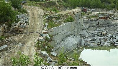 Quarry mining granite open-cast. Horizontal pan