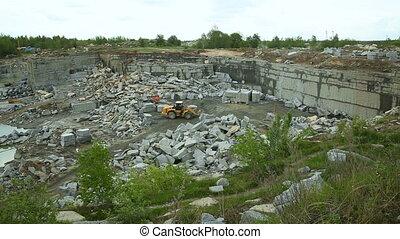 Quarry mining granite open-cast. Vertical pan