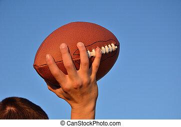 Quarterback Passing an American Football - Quarterback...