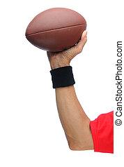 Quarterbacks arm with football