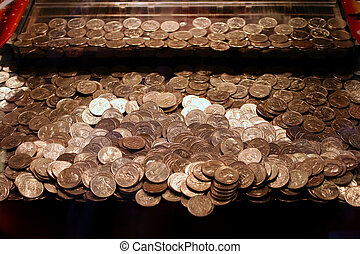 Piles of quarters in an arcade game.