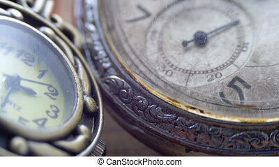 Quartz and mechanical clocks lie side by side, looking close...