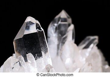 Quartz crystals on black background