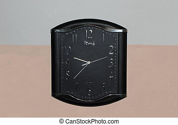 Quartz wall clock. - Black watch with a second hand electric...
