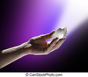 Quartz Wand in Magenta White Light - Male Hand holding a...