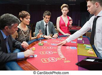 quatre personnes, poker jouant