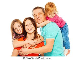 quatro, sorrindo, abraçando, família, feliz
