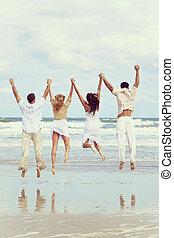 quattro persone, giovane, due coppie, saltare, spiaggia, celebrazione