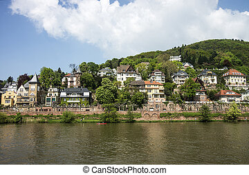 Quay of Neckar river in Heidelberg in summer sunny weather