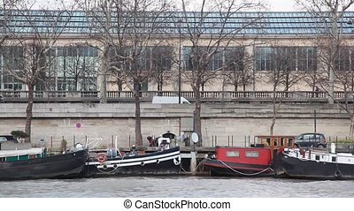quay of Siene river in Paris with motor cutters