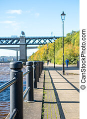 Quayside along Tyne River, in Newcastle. With blurred image...