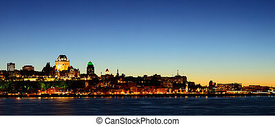 Quebec City skyline panorama at dusk over river viewed from Levis.