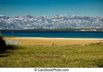 Queen's sand beach in Nin and Velebit mountain, Croatia