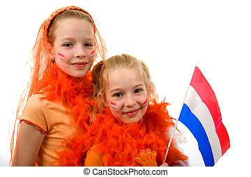Young girls posing in orange with balloon and flag, isolated on white background
