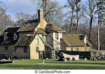 the park of the castle of Versailles - Queen's Hamlet in the...