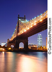 Queensboro Bridge over New York City East River at dusk viewed from midtown Manhattan.