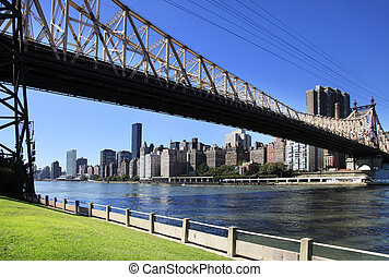 Queensboro Bridge Spanning the East River in New York City on a sunny day