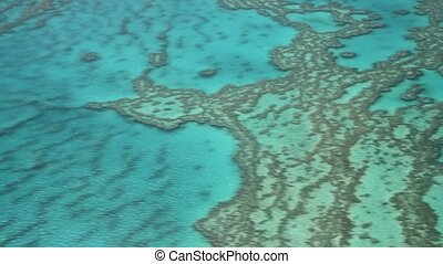 Queensland Coral Reef, Australia. The great barrier reef seen from a flying airplane. Slow motion