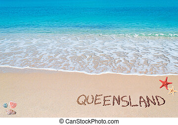"queensland writing - ""queensland"" written on a tropical..."