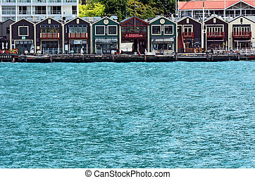 QUEENSTOWN, NZ - JAN 16:Queenstown waterfront on Jan 16 2014.It's one of the most popular travel destination in New Zealand known for it's restaurants, ski tourism and extreme sport adventure.