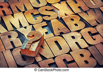 question mark and alphabet in wood type