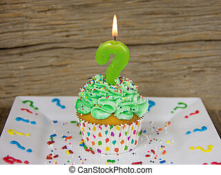 question mark birthday candle on cupcake