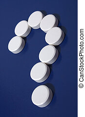 Question mark of white tablets
