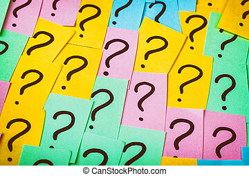 Question marks background. Colorful paper notes with question marks. Concept image. Closeup top view toned