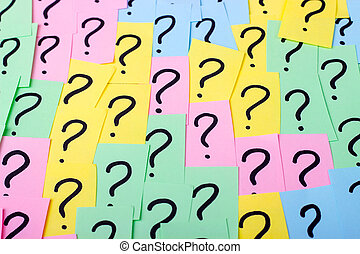 Question marks. Colorful paper notes with question marks. Concept image. Closeup.