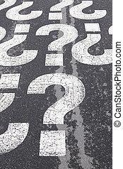 Question sign on asphalt