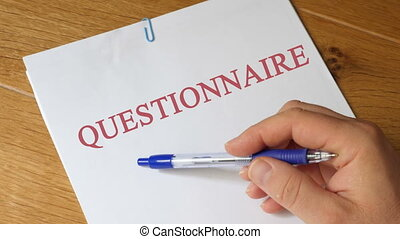 Questionnaire on a wooden table