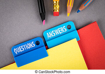 QUESTIONS and ANSWERS concept. Folder Register of Card Index. Colored pencils and paper