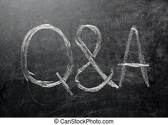 Questions and answers on a black chalkboard