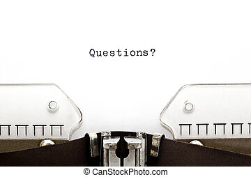 Questions? printed on an old typewriter
