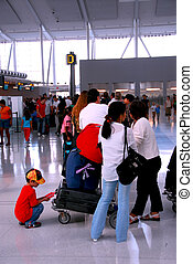 Long queue of people at modern international airport
