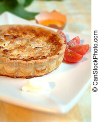 Tasty quiche in a plate