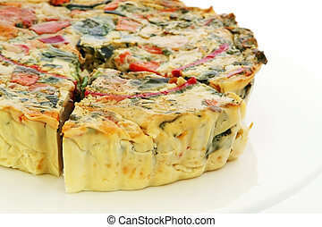 Quiche: A whole vegetarian quiche, with one cut wedge.