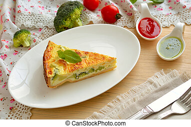 Quiche is a savoury, open-faced pastry crust with a filling of savoury custard with cheese, Broccoli and mushrooms.