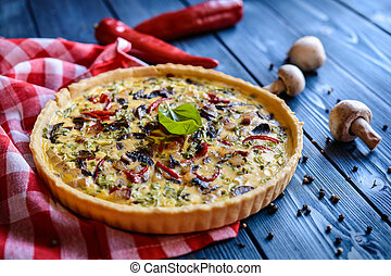 Traditional quiche with mushrooms, red bell pepper, bacon and green onion