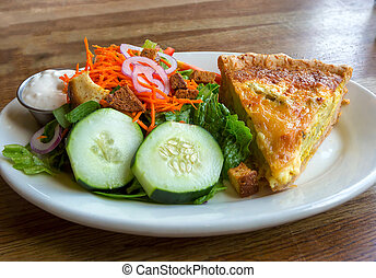 Quiche with Salad and Dressing Closeup