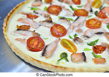 Quiche with salmon and cherry tomatoes