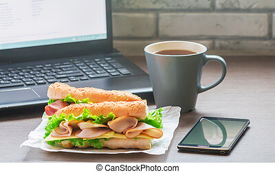 Quick lunch in the office sandwich and a cup of tea on the...