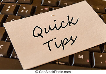 Quick tips text concept note on dark keyboard background