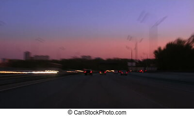 Quick traffic on autobahn, sunset.