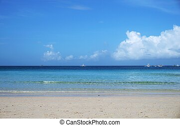 Quiet beach with blue sky