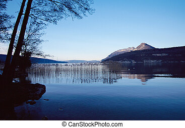 Quiet blue lake of Annecy, landscape in France