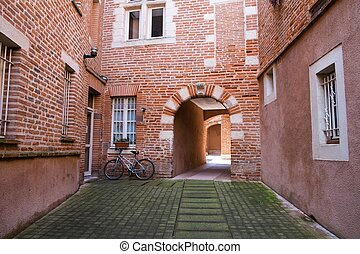 Quiet patio with bicycle in Albi town, France